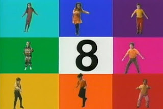 Eight children dance in a colour block grid and counting till 8. Sesame Street 123 Count with Me