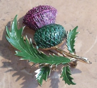 Large enamelled thistle brooch by Exquisite