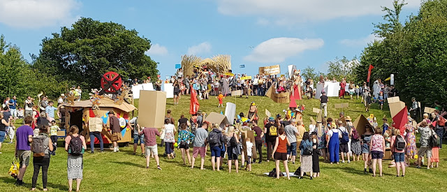 Timber Festival Review Sunday Cardboardia Parade travelling up the big hill stand off