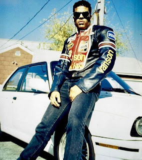 Picture of Albert Brown IV's dad with a car