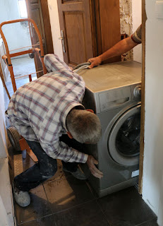 Pushing the washing machine into the room