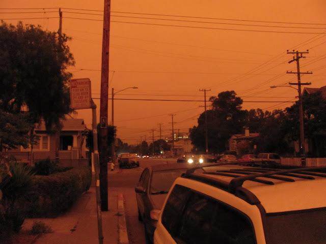Dark orange sky over an Oakland, CA street
