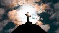 Cross on hill - Photo by Nicolas Peyrol on Unsplash