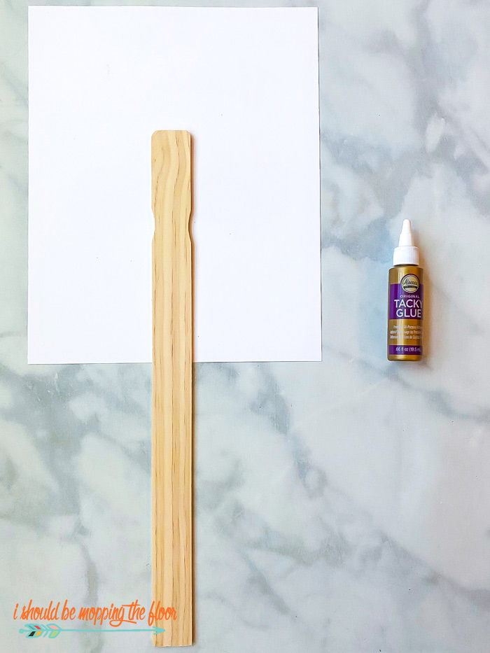 Sign Glued to Paint Stick