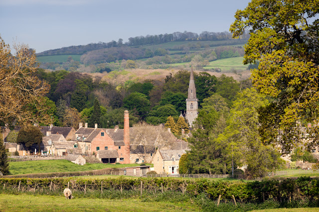 Lower Slaughter under the afternoon sunshine with surrounding Cotswolds countryside