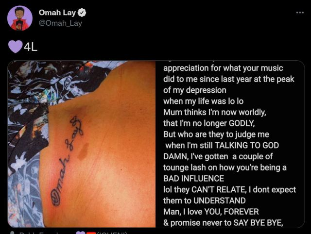 Omah lay reacts as Fan tattoos his name on her Belly (Photos)