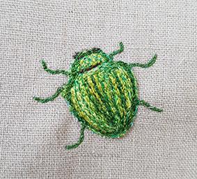 Grøn bille maskin broderet