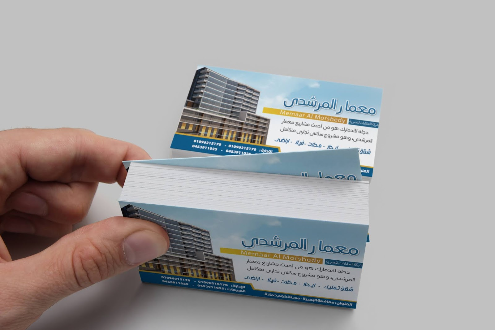 Blue business card design for contracting and real estate