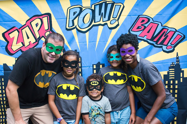 Photo backdrop and batman t-shirts at a batman party