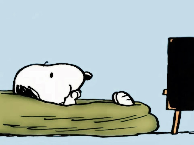 Snoopy sitting in a bean bag, eating snacks and watching TV. Does sighing count as exercise?