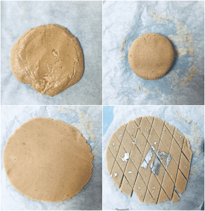 kaju katli dough on parchment paper, kneaded dough rolled out and diamond shape cut kaju katli on paper
