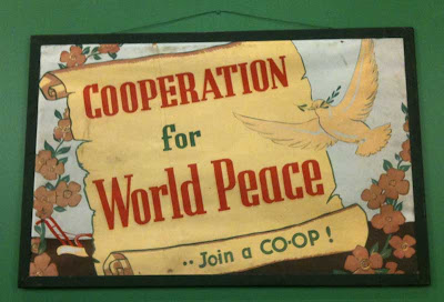 Early 20th century poster with dove and the words Cooperation for world peace -- join a co-op!