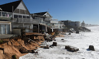 June 2016's devastating storms damaged beachfront homes on Sydney's northern beaches. Some are calling for a seawall to be put in place. (Photograph Credit: Dean Lewins/AAP) Click to Enlarge.