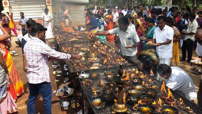 Devotees Lighting Oil Lamps At Kuchanur Saneeswara Temple