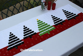 black and green striped trees on a red and white background for a table runner by QuiltFabrication