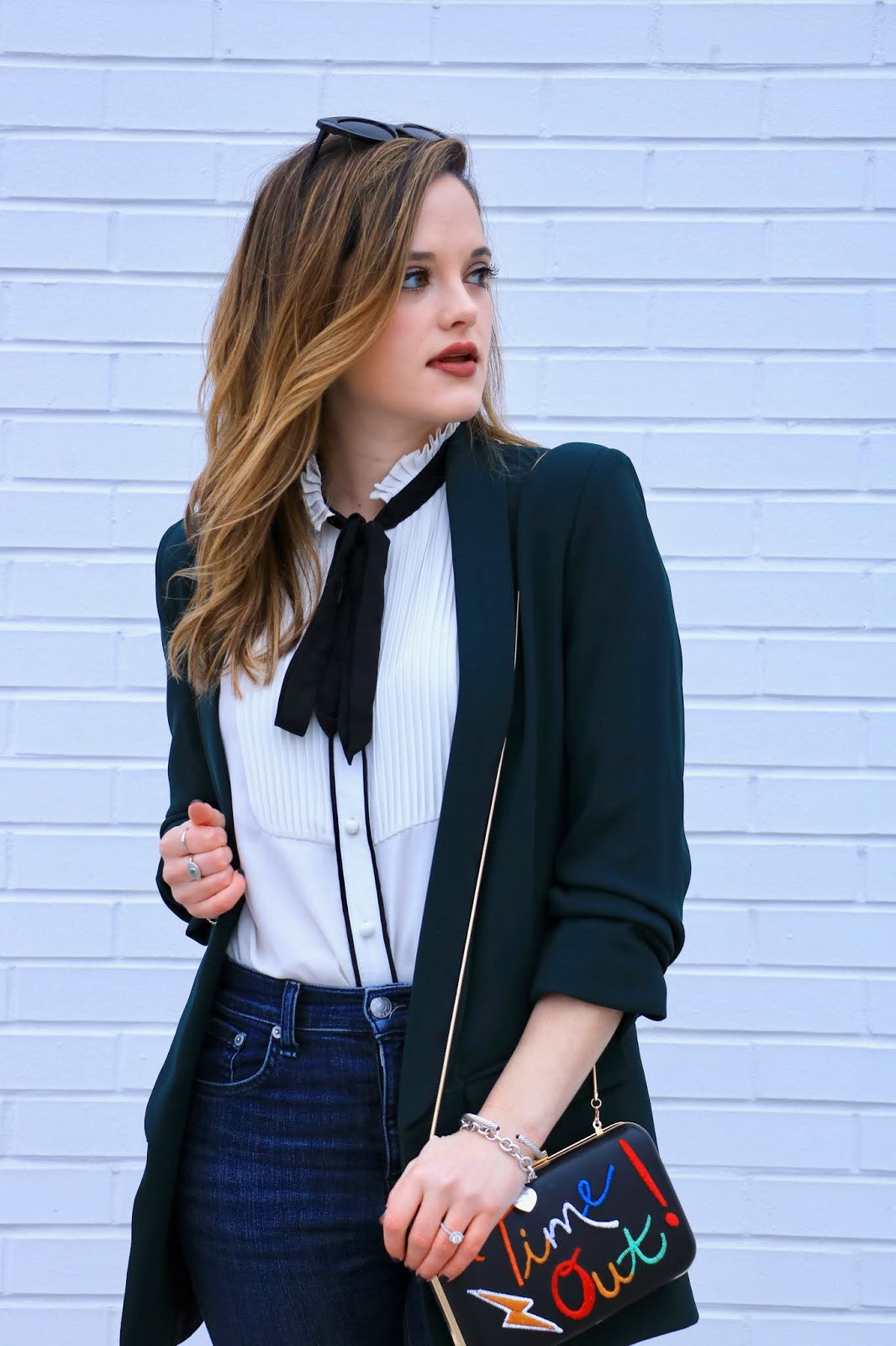 Nyc fashion blogger Kathleen Harper wearing an outfit with a high neck ruffle blouse.