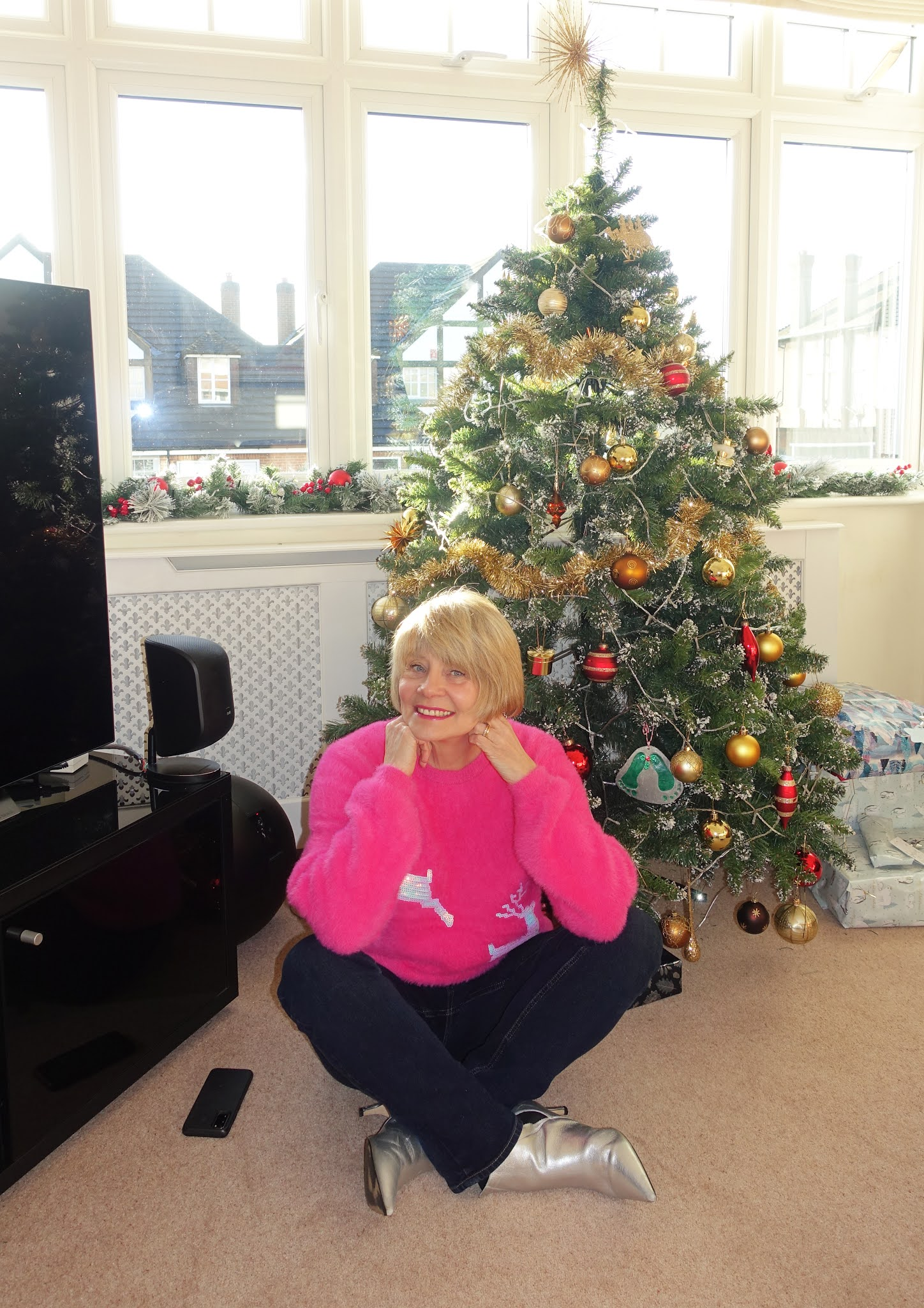 Gail Hanlon from style blog Is This Mutton? in her 2020 Christmas jumper bought from the children's dept of Marks and Spencer
