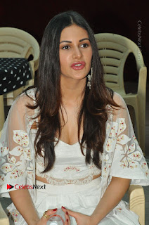 Telugu Actress Amyra Dastur Stills in White Skirt and Blouse at Anandi Indira Production LLP Production no 1 Opening 0004