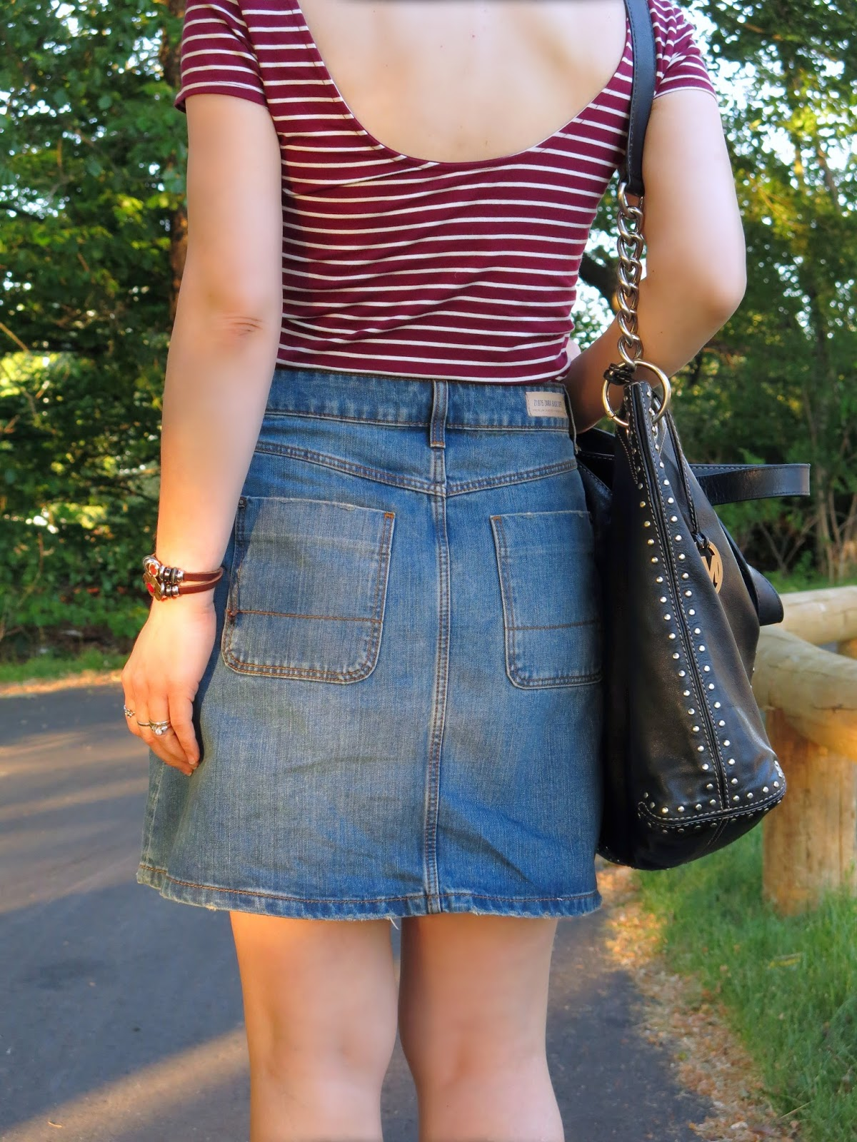 styling a button-front A-line mini skirt with a striped t-shirt