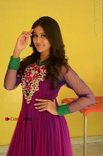 Actress Pooja Jhaveri Latest Stills in Purple Salwar Kameezt at Dwaraka Success Meet  0078.JPG