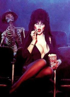Elvira eating popcorn