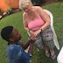 Photos of a young Nigerian man proposing to his old white lover