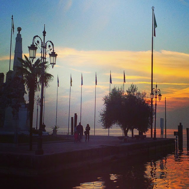 A romantic sunset in Lazise on the shores of Lake Garda in Italy