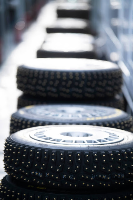 Stack of studded rally tyres