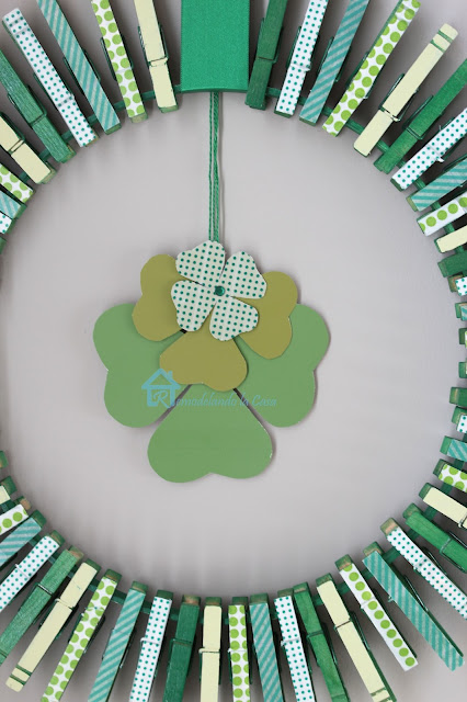 using clothespins and embroidery hoop to create a wreath for st. paddy