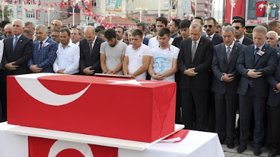 President Erdogan attends the funeral of a mother and her infant son killed by a roadside bomb.