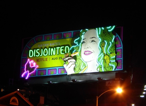 Disjointed neon moving hand billboard installation