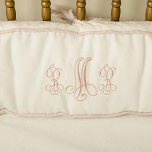 Unique We would suggest a classic monogrammed bedding set like our plush gingham set available in pink blue green and red although something tells us this little