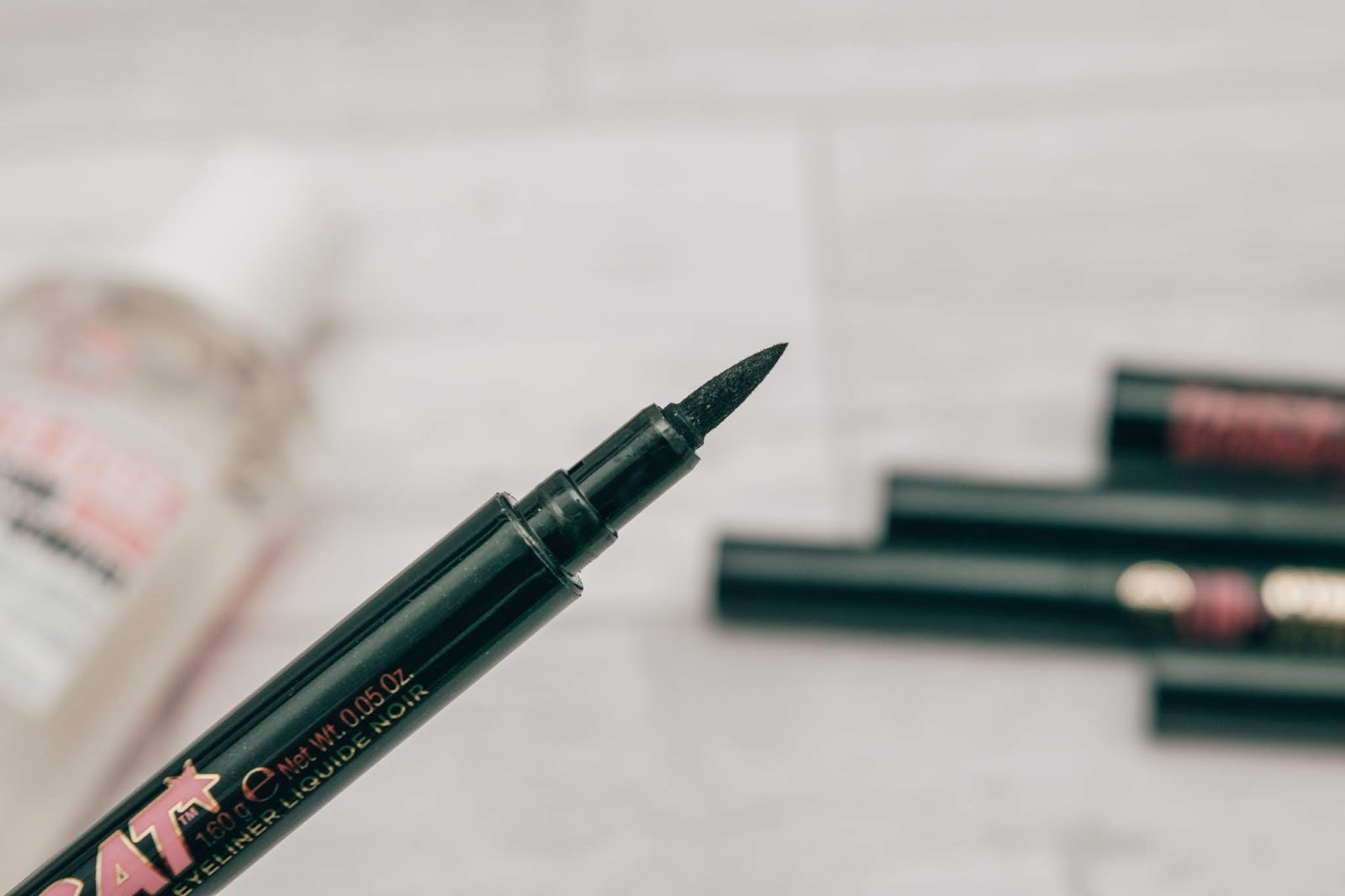 A close up of a black eyeliner pen
