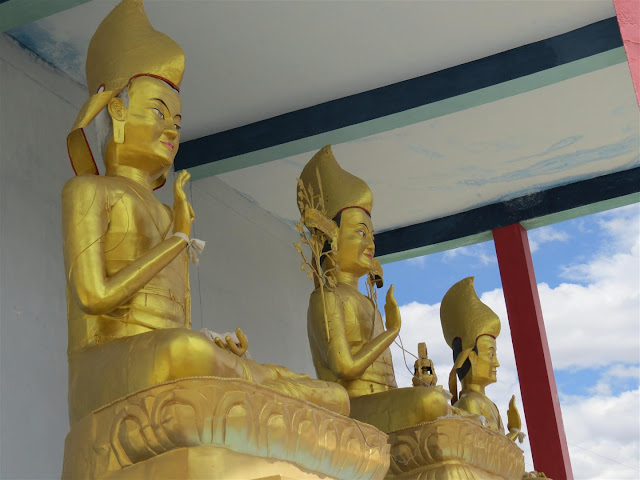 Three statues in Golden near Kye Monastery