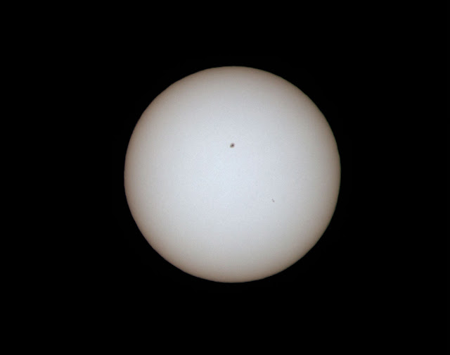 Two visible sunspots in this image with 600mm DSLR, 1/1000 second, ND100000 filter (Source: Palmia Observatory)