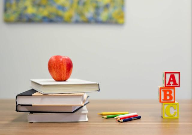 Photo by Element5 Digital on Unsplash school books, alphabet blocks and apple