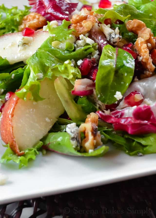 Savory Pear Pomegranate Salad with Walnuts and a creamy White Balsamic Vinaigrette is a favorite salad side dish recipe for Thanksgiving or Christmas from Serena Bakes Simply From Scratch.