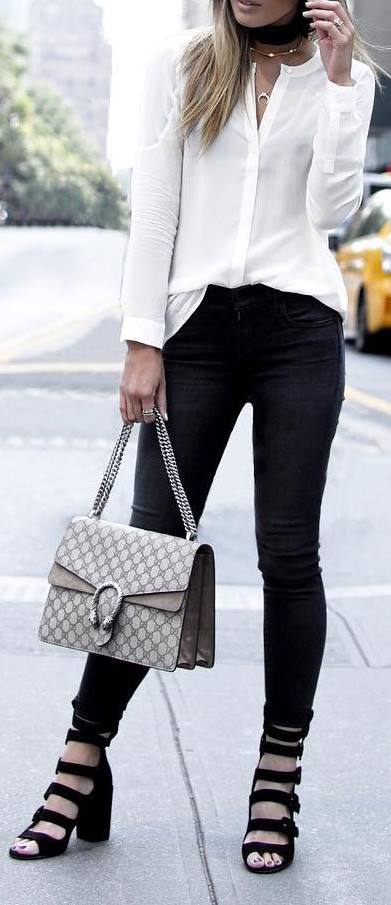 Street style outfit idea: blouse + jeans + heels + bag