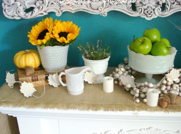 Friday's Find #145 mythriftstoreaddiction.blogspot.com A collection of vintage milk glass filled with flowers and fruit creates a charming mantel