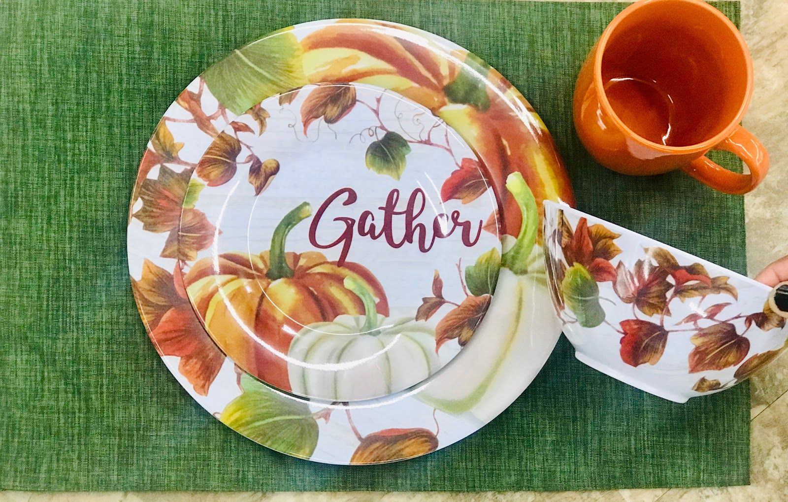 Image: Fall plates, cups and bowls. First, I was looking at the green matched with the bowl, plate, and orange cup. I am definitely feeling the green vibe, but the mats may look better during Christmas time.