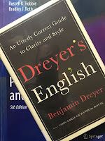Dreyer's English, by Benjamin Dreyer, superimposed on Intermediate Physics for Medicine and Biology.