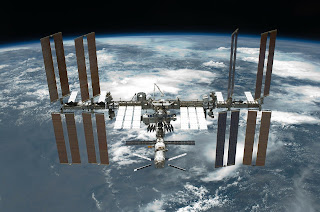 With visible water, cumulonimbus and cirrocumulus clouds, and cirrus clouds: in heaven, the International Space Station.