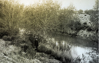 An old black & white picture of a man standing by an old Hohokam canal. Photo from AZ Historical Society 1907