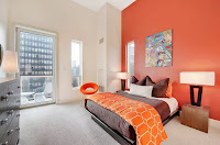 Bedroom with orange wall color