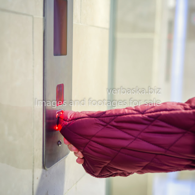 woman is panicked when she needs to press an elevator button