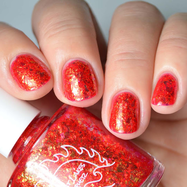 red flakie nail polish four finger swatch