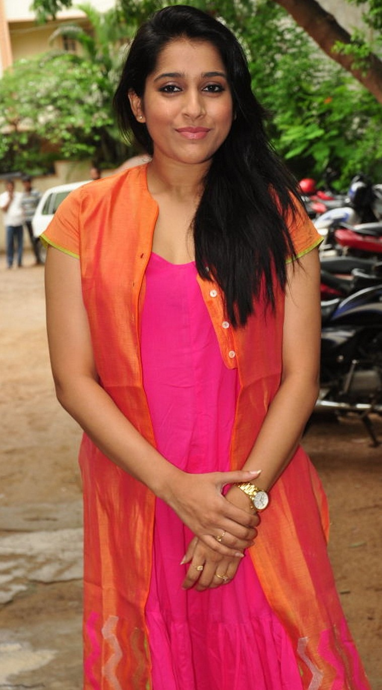 Indian TV Anchor Rashmi Gautam Long Hair Hot Looking Face Stills In Orange Dress