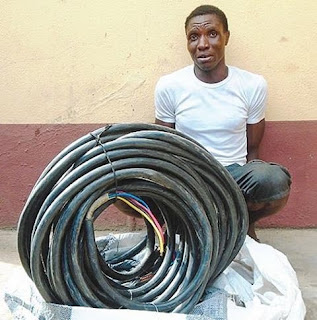"""Man Caught With Stolen Bundle Of Cable From Ambode's """"Light Up Lagos"""" Project"""