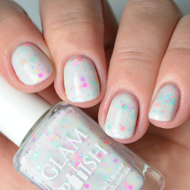 white nail polish with glitter four finger swatch