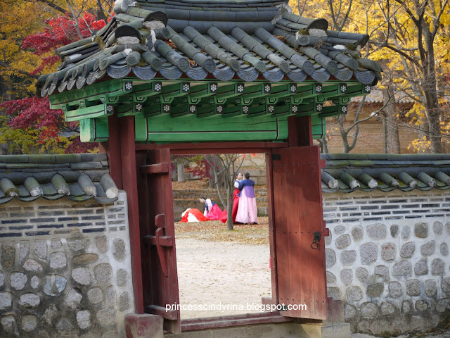 girls in traditional Korean costume as seen from gate
